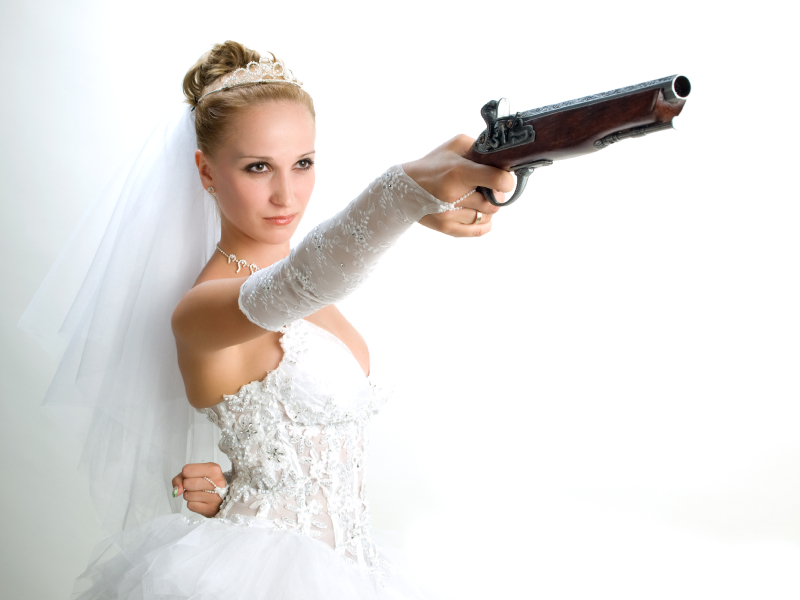 bride holding the old gun