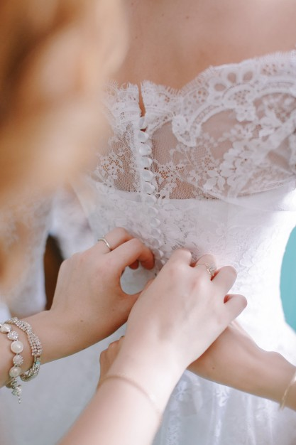 adjusting-the-corse-of-the-bride_1157-285